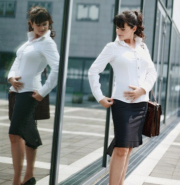 mature-business-woman-posing-outside-office-5WUHU7L
