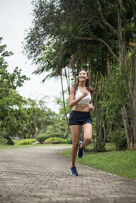 young-beautiful-sport-woman-running-at-the-park-he-CHYKH6K